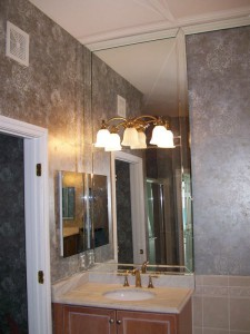 Bathroom Vanity mirror with beveled overlay frame.