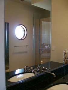 Vanity mirror with faucet thru the mirror