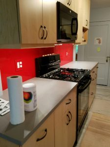 Painted red glass back splash